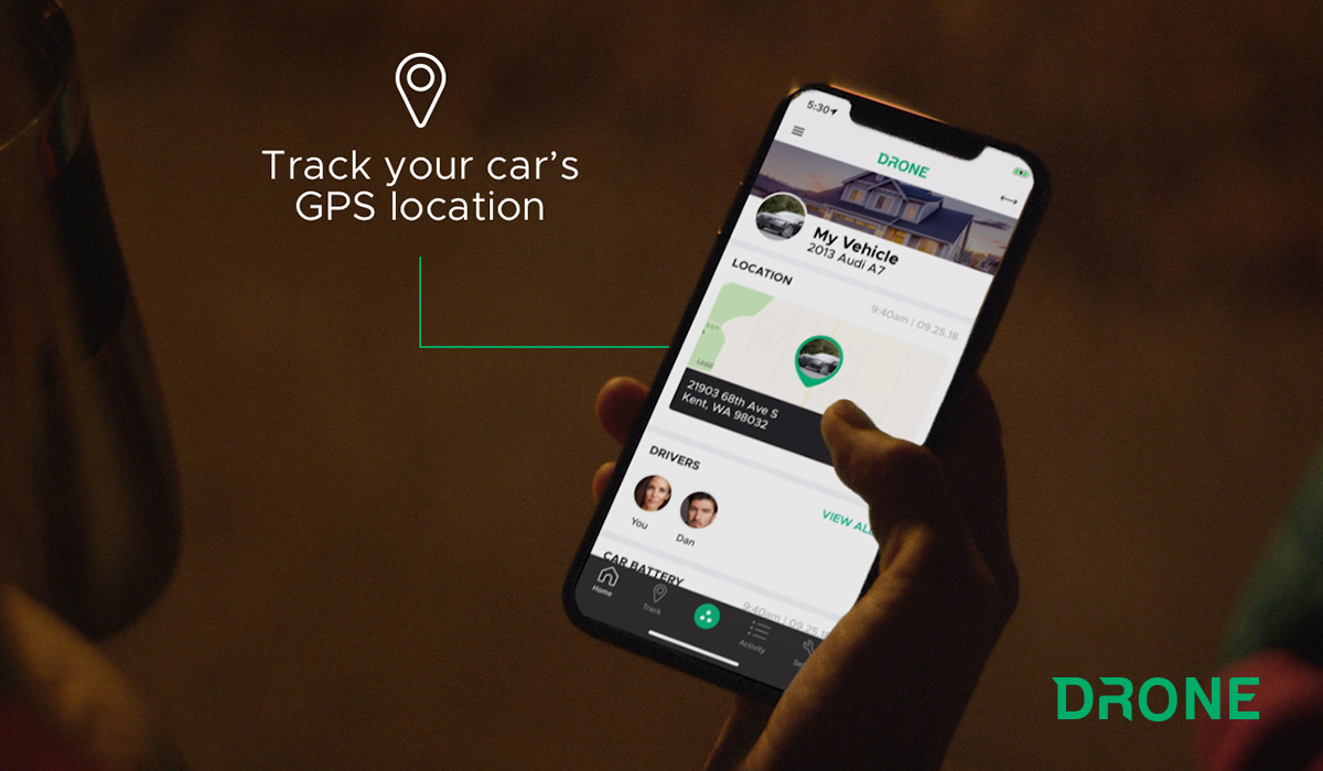 """Phone with DroneMobile app open. A pin icon and the words """"Track your car's GPS location"""" to the left."""