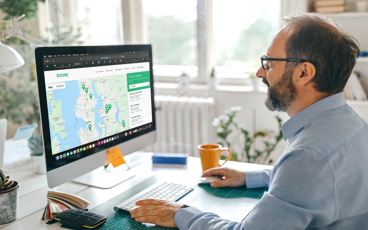 Man using DroneMobile Dealer Locator on computer